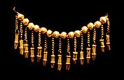 Necklace of 14 melon-shaped gold beads and 15 cylindrical gold pendants on chains 800-700 BC. The cylindrical sections of the pendants originally passed through breads of amber or rock-crystal so that the whole resembled a pomegranate