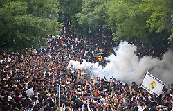 Fans with flares outside the stadium prior to the match