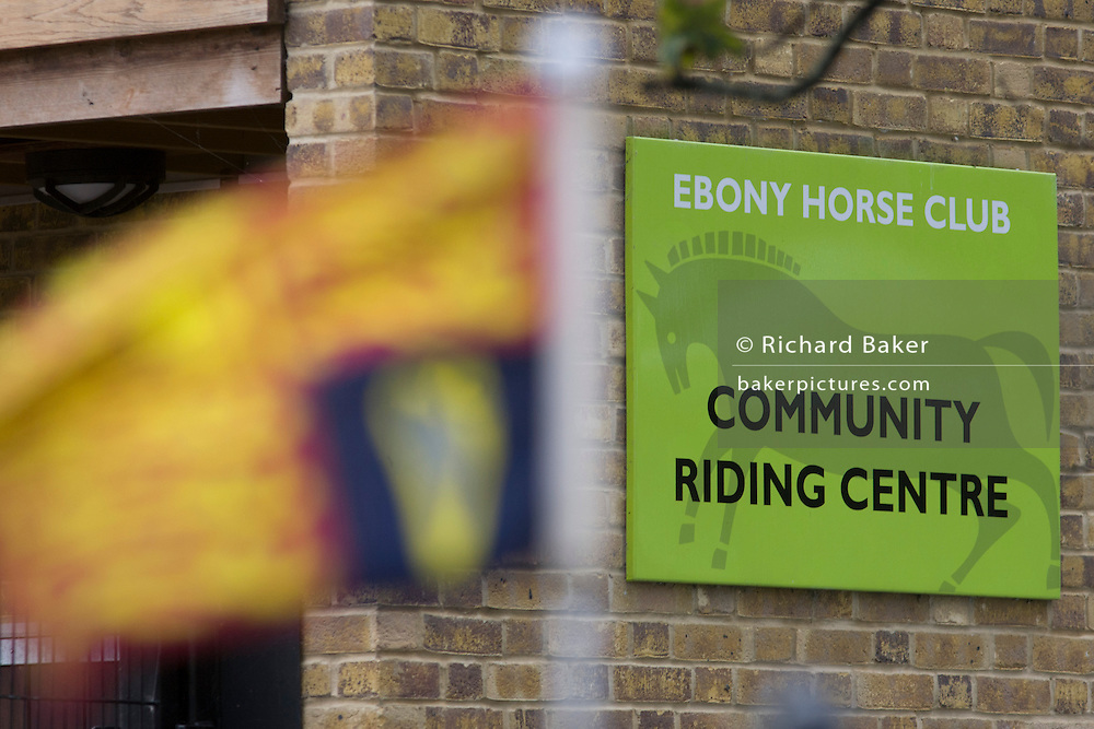 Queen Elizabeth made a brief visit to the Ebony Horse Club at Loughborough Junction, Brixton, London. Accompanied by the Duchess of Cornwall, Her Majesty watched an equestrian demonstration in one of the most disadvantaged inner city neighbourhoods in the country where there is a historic legacy of under-achievement in schools, high rates of teenage pregnancy and negative stereotypes of young people, gang violence and drug related crime.