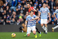 Juan Mata of Manchester United fouls Joey Barton, the QPR captain. Barclays Premier league match, Queens Park Rangers v Manchester Utd at Loftus Road in London on Saturday 17th Jan 2015. pic by John Patrick Fletcher, Andrew Orchard sports photography.