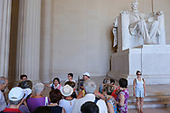 WASHINGTON - JUNE 30, 2019: A tour guide speaks as visitors gather at the Lincoln Memorial on June 30, 2019, in Washington, D.C.