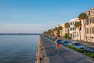A runner jogs along the Battery on East Battery St. / East Bay Street in Charleston.