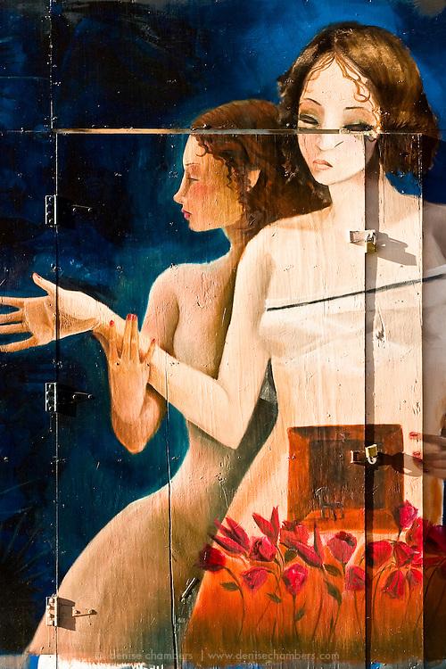 Mural of two ladies painted on a door in downtown San Jose.