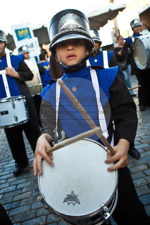 A young drummer parades at the Festival of San Sebastian in San Juan, Puerto Rico.