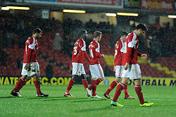 Bristol City players exit the pitch after losing to Watford - Photo mandatory by-line: Dougie Allward/JMP - Tel: Mobile: 07966 386802 14/01/2014 - SPORT - FOOTBALL - Vicarage Road - Watford - Watford v Bristol City - FA Cup - Third Round - replay