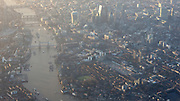 View of the City of London at sunrise taken from an aeroplane on the descent towards Heathrow Airport.