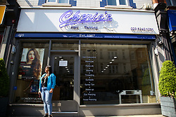 © Licensed to London News Pictures. 24/04/2020. London, UK. An exterior view of a hairdresser in north London. According to government officials, hairdressers could be forced to remain closed for six more months to reduce the risk of the spread of COVID-19. Photo credit: Dinendra Haria/LNP