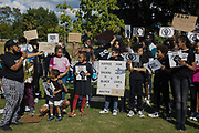 Young people hold signs bearing the names of people who died in police custody during a peaceful protest in solidarity with the Black Lives Matter movement on 13th June 2020 in Salt Hill Park in Slough, United Kingdom. Protests in solidarity with the Black Lives Matter movement have taken place across the United States and in many countries around the world.