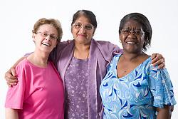 Multiracial group of older women smiling,