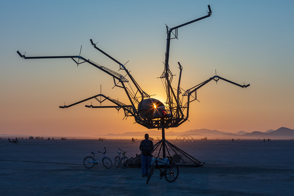 Spider Sweet by: Bryan Argabrite from: Santa Cruz, CA year: 2018<br /> <br /> Spider sweet is a maneuverable spider that draws in spectators to explore her postures and watch her come alive with color as the sun sets. A contractor by trade with an eye for transformation, Bryan Argabrite's first Burning Man Honoraria project was inspired by the symmetry of an airplane engine and the intention to change the perception of a misunderstood creature and the fears within all of us.<br /> <br /> Contact: spidersweetproject@gmail.com