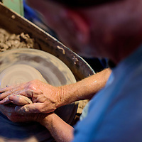 070315       Cable Hoover<br /> <br /> Peter McCabe shapes a mound of clay into a bowl on his potter's wheel at his home in Candy Kitchen Friday.