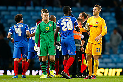 Marvin Bartley and Gary Woods of Leyton Orient congratulate each other after Leyton Orient win 0-1, with Shay Given of Aston Villa looking dejected behind - Photo mandatory by-line: Rogan Thomson/JMP - 07966 386802 - 27/08/2014 - SPORT - FOOTBALL - Villa Park, Birmingham - Aston Villa v Leyton Orient - Capital One Cup Round 2.