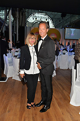 RICHARD E GRANT and his wife JOAN WASHINGTON at the GQ Men Of The Year 2014 Awards in association with Hugo Boss held at The Royal Opera House, London on 2nd September 2014.