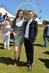 Jamie Campbell-Bower and Matilda Lowther at the Cartier Style et Luxe at the Goodwood Festival of Speed, Goodwood, West Sussex, England. 2 July 2017.<br /> Photo by Dominic O'Neill/SilverHub 0203 174 1069 sales@silverhubmedia.com