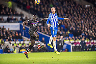 Brighton and Hove Albion (17) Glenn Murray, Crystal Palace (12) Mamadou Sakho during the Premier League match between Brighton and Hove Albion and Crystal Palace at the American Express Community Stadium, Brighton and Hove, England on 28 November 2017. Photo by Sebastian Frej.