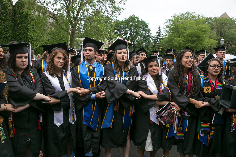Notre Dame students walk out of the commencement ceremony as Vice President Mike Pence was introduced at Notre Dame Stadium on Sunday, May 21, 2017, in South Bend. Tribune Photo/SANTIAGO FLORES