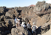 Tourists at caves and blow holes rocky coastline Los Hervideros, Lanzarote, Canary Islands, Spain