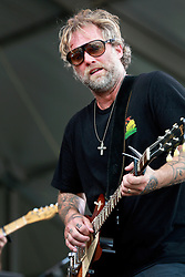 26 April 2014. New Orleans, Louisiana.<br /> Anders Osborne plays the New Orleans Jazz and Heritage Festival. <br /> Photo; Charlie Varley/varleypix.com