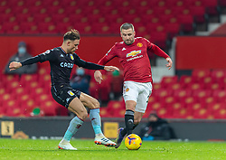MANCHESTER, ENGLAND - Friday, January 1, 2020: Manchester United's Luke Shaw (R) and Aston Villa's Matthew Cash during the New Year's Day FA Premier League match between Manchester United FC and Aston Villa FC at Old Trafford. The game was played behind closed doors due to the UK government putting Greater Manchester in Tier 4: Stay at Home during the Coronavirus COVID-19 Pandemic. (Pic by David Rawcliffe/Propaganda)