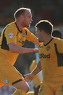 Lee Minshull of Newport celebrates scoring his side's equalising goal with Danny Crow. Skybet football league two match, Newport county v Exeter city at Rodney Parade in Newport, South Wales on Sunday 16th March 2014.<br /> pic by Mark Hawkins, Andrew Orchard sports photography.