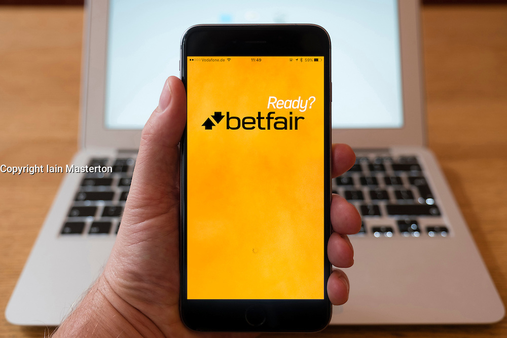 Using iPhone smartphone to display homepage logo of Betfair gambling app