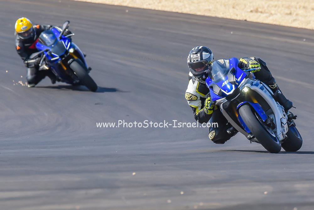 Motorbike racing in circuit. Photographed in Israel