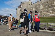 Visitors to Windsor Castle wear face coverings to help prevent the spread of the coronavirus on 26 September 2020 in Windsor, United Kingdom. The Royal Borough of Windsor and Maidenhead is aware of a rise in local coronavirus infections, has a COVID-19 outbreak management plan in place to try to ensure that the numbers do not increase further and has requested access to more coronavirus testing sites with this in mind.