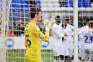 Peterborough Utd goalkeeper Conor O'Malley (25) takes a drink while Coventry players celebrate in the background during the EFL Sky Bet League 1 match between Peterborough United and Coventry City at London Road, Peterborough, England on 16 March 2019.