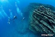 scuba divers at Niihau Arches dive site, off Niihau, Hawaii ( Central Pacific Ocean )
