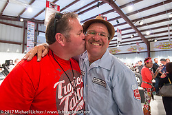 Roadside Marty give Kiwi Mike a big kiss at the Old Iron - Young Blood exhibition media and industry reception in the Motorcycles as Art gallery at the Buffalo Chip during the annual Sturgis Black Hills Motorcycle Rally. Sturgis, SD. USA. Sunday August 6, 2017. Photography ©2017 Michael Lichter.