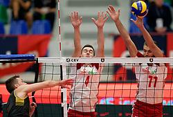 17-09-2019 NED: EC Volleyball 2019 Montenegro - Poland, Amsterdam<br /> First round group D - Poland win 3-0 / Marcin Komenda #4 of Poland, Karol Klos #77 of Poland