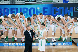 Roman Volcic of Slovenian Basketball Federation and Vytenis Cizauskas of Lithuania with Winning team of Lithuania celebrate during Trophy ceremony after the basketball match between National teams of Lithuania and France in final match of U20 Men European Championship Slovenia 2012, on July 22, 2012 in SRC Stozice, Ljubljana, Slovenia. Lithuania defeated France 50-49 and became European Champion 2012. (Photo by Vid Ponikvar / Sportida.com)