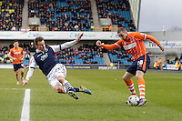 Blackpool's Martin Paterson gets a cross in despite the attentions of Millwall's Jed Wallace<br /> <br /> Photographer Craig Mercer/CameraSport<br /> <br /> Football - The Football League Sky Bet League One - Millwall v Blackpool - Saturday 5th March 2016 - The Den - Millwall<br /> <br /> © CameraSport - 43 Linden Ave. Countesthorpe. Leicester. England. LE8 5PG - Tel: +44 (0) 116 277 4147 - admin@camerasport.com - www.camerasport.com