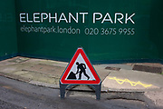 A Man at Work sign at Elephant Park, as new development at Elephant & Castle, on 4th January, London borough of Southwark, England. Southwark Council's development partner, Lendlease is regenerating over 28 acres across three sites at the heart of Elephant & Castle, in what is the latest major regeneration opportunity in zone 1 London. The vision for the £1.5 billion regeneration is to build on the area's strengths and vibrant character in order to re-establish Elephant & Castle as one of London's most flourishing urban quarters. The Elephant & Castle regeneration is of a scale rarely seen in central London and includes almost 3,000 new homes, plus office, retail, community, leisure and restaurant space.
