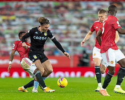 MANCHESTER, ENGLAND - Friday, January 1, 2020: Aston Villa's captain Jack Grealish (R) is tackled by Manchester United's Frederico Rodrigues de Paula Santos 'Fred' during the New Year's Day FA Premier League match between Manchester United FC and Aston Villa FC at Old Trafford. The game was played behind closed doors due to the UK government putting Greater Manchester in Tier 4: Stay at Home during the Coronavirus COVID-19 Pandemic. (Pic by David Rawcliffe/Propaganda)