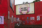 Art work by Dr D. at Shangri-la at the Glastonbury Festival 22th July 2016, Somerset, United Kingdom. No-one is listening. Shangri-la is a venue at the festival with  art and politics mixed with tunes and all night club nights. Work getting the festival ready takes weeks and in the days up to the festival starts work is frantic.  The Glastonbury Festival runs over 3 days and has 3000 acts, including music, art and performance and approx. 150.000 attend the anual event.