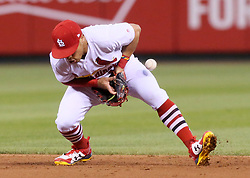 June 9, 2017 - St Louis, MO, USA - St. Louis Cardinals second baseman Kolten Wong commits a fielding error as the Philadelphia Phillies' Freddy Galvis reaches in the fourth inning on Friday, June 9, 2017, at Busch Stadium in St. Louis. The Cards won, 3-2. (Credit Image: © Chris Lee/TNS via ZUMA Wire)