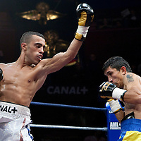 19 November 2009: Fight between Redouane Asloum (white trunks) and Kemal Plavci (yellow and blue trunks) during the Grand Tournoi boxing semi finals event at Cirque d'Hiver in Paris, France.