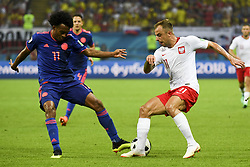 June 25, 2018 - Kazan, Russia - Kamil Grosicki of Poland and Juan Cuadrado of Colombia during the 2018 FIFA World Cup Group H match between Poland and Colombia at Kazan Arena in Kazan, Russia on June 24, 2018  (Credit Image: © Andrew Surma/NurPhoto via ZUMA Press)