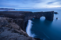 The small peninsula, or promontory, Dyrhólaey (120m high) is located on the south coast of Iceland, not far from the village Vík. It was formerly an island of volcanic origin, which is also known by the Icelandic word eyja meaning island. This view is to the east towards Reynisfjara.