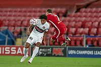 Football - 2020 / 2021 Champions League - Group D - Liverpool vs FC Midtjylland - Anfield<br /> <br /> Liverpool's James Milner  is fouled by Midtjylland's JENS-LYS CAJUSTE<br /> <br /> COLORSPORT/TERRY DONNELLY