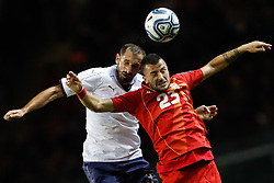 October 6, 2017 - Turin, Italy - Giorgio Chiellini (L) of Italy national team and Ilija Nestorovski of FYR Macedonia national team vie for a header during the 2018 FIFA World Cup Russia qualifier Group G football match between Italy and FYR Macedonia at Stadio Olimpico on October 6, 2017 in Turin, Italy. (Credit Image: © Mike Kireev/NurPhoto via ZUMA Press)
