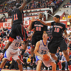 Seton Hall Pirates forward Patrik Auda (33) has his lane to the basket blocked by leaping Rutgers Scarlet Knights guard/forward Dane Miller (11), forward Kadeem Jack (22) and guard/forward Mike Poole (10)  during first half Big East NCAA Basketball between the Rutgers Scarlet Knights and Seton Hall Pirates at the Louis Brown Athletic Center. Rutgers leads Seton Hall 28-26 at halftime.