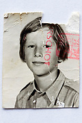 damaged document photo of a young boy 1970s