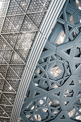 Interior of the Louvre Abu Dhabi with detail of the steel roof dome at Saadiyat Island Cultural District in Abu Dhabi, UAE. Architect Jean Nouvel