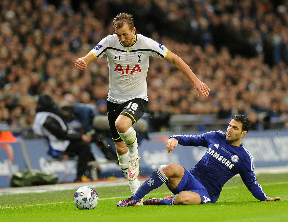Tottenham Hotspur's Harry Kane evades the challenge from Chelsea's Cesc Fabregas<br /> <br /> Photographer Ashley Crowden/CameraSport<br /> <br /> Football - Capital One Cup Final - Chelsea v Tottenham Hotspur - Sunday 1st March 2015 - Wembley - London<br />  <br /> © CameraSport - 43 Linden Ave. Countesthorpe. Leicester. England. LE8 5PG - Tel: +44 (0) 116 277 4147 - admin@camerasport.com - www.camerasport.com