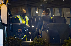 © Licensed to London News Pictures. 15/02/2021. London, UK. Security guards and a driver sit in a coach outside the Radisson hotel where people are arriving for quarantine near Heathrow Airport. People entering the UK from a 'red list' of 33 high risk countries will have to quarantine at hotels for 10 days to try and stop new coronavirus variants entering the country. Photo credit: Peter Macdiarmid/LNP