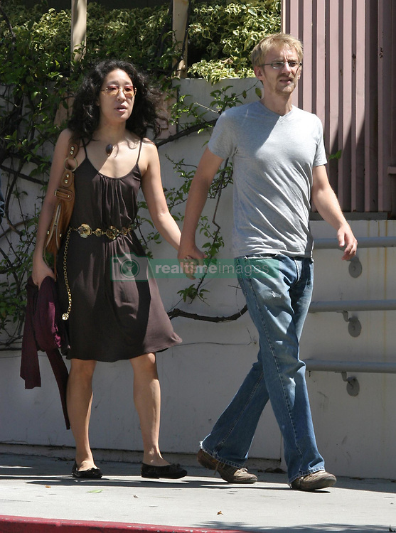 """©2006 RAMEY PHOTO 310-828-3445<br /> <br /> EXCLUSIVE<br /> <br /> Sandra OH is weekly on """"Grey's Anatomy"""" as Cristina Yang, a young medical intern learning the ropes at Seattle Grace Hospital. Sandra has also received an Emmy nomination for Best Supporting Actress in a drama series for her portrayal of Cristina.<br /> <br /> In 2003, she married writer-director Alexander Payne and their first film together was the Oscar-winning Sideways (2004) but they just filed for divorce few months ago.<br /> <br /> She found love again and everything go quickly with  Andrew Featherston 28 (7 year younger)<br /> During this labor day week end she meet the Featherston, Shawn and Joy who came from Minneapolis to meet Sandra.<br /> She seemed very happy and in love with Andrew<br /> They bought art painting stuff at """"Blick art material"""" before visiting the LACMA Museum.<br /> <br /> SV/VL/AAAP (Mega Agency TagID: MEGAR137709_23.jpg) [Photo via Mega Agency]"""