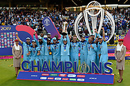Champions - Eoin Morgan of England and his England team celebrate with the Cricket World Cup trophy during the ICC Cricket World Cup 2019 Final match between New Zealand and England at Lord's Cricket Ground, St John's Wood, United Kingdom on 14 July 2019.