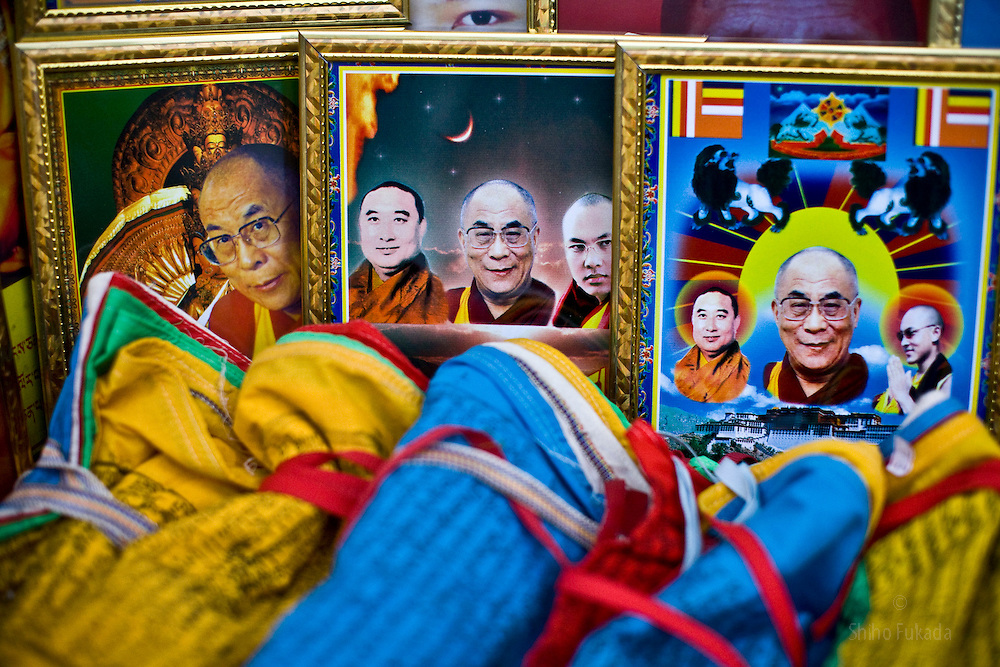 Tibet New Year - China - Edward Wong<br /> A local shop sells pictures of Dalai Lama in Rebkong (Tongren in Chinese), Qinghai province in China, February 24, 2009. Photo by Shiho Fukada for The New York Times